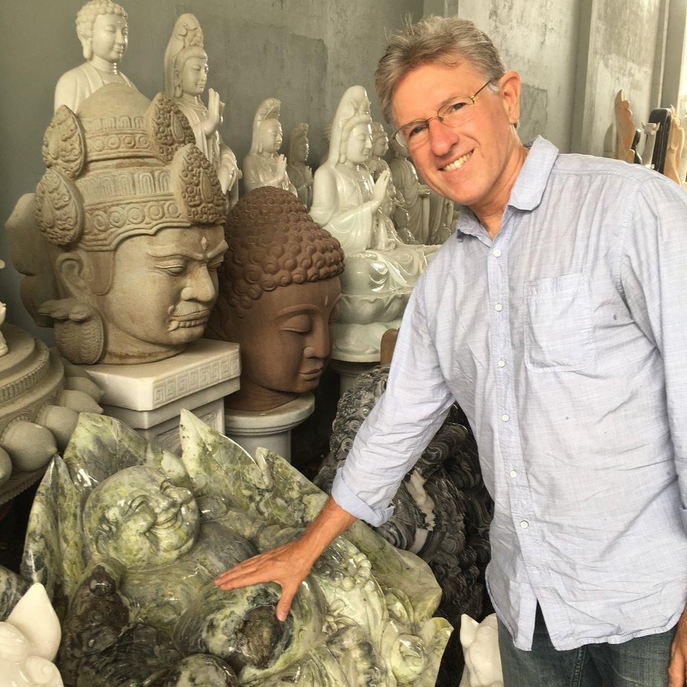 Jim amongst buddhas happy and stern.jpeg