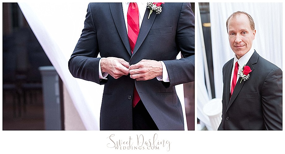 Groom getting ready in red tie