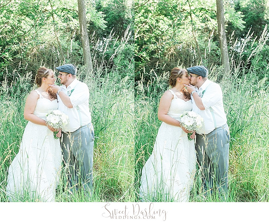 bride and groom in the woods kissing