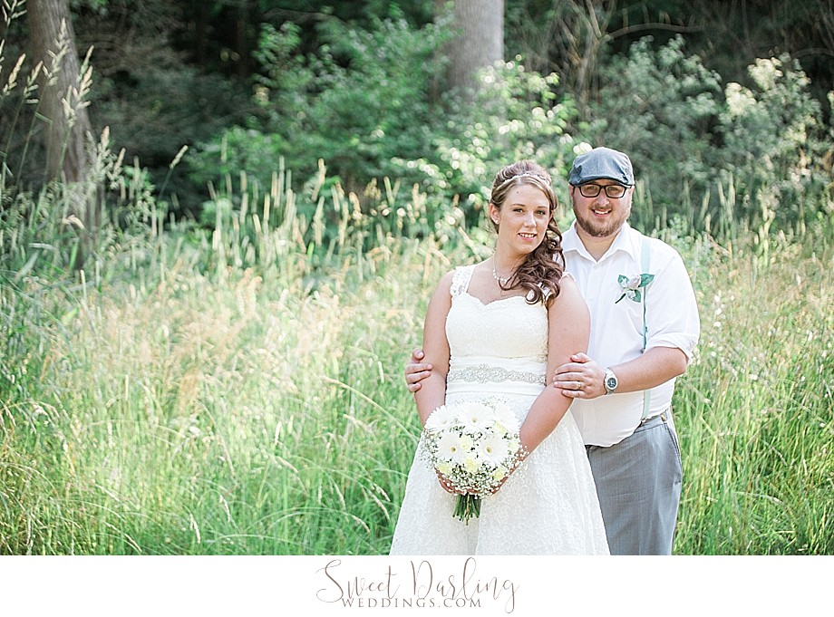 groom in newsboy cap and bride for outdoor portraits
