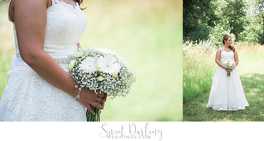Bride with bouquet of white daisies and baby breath