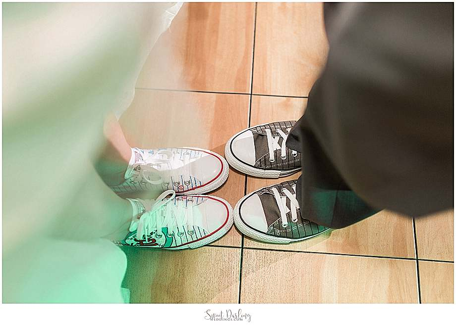 hand painted Chuck Taylor Converse shoes on bride and groom