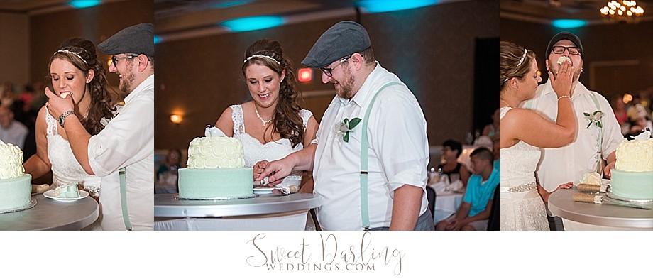 Bride and groom cutting the seafoam green wedding cake
