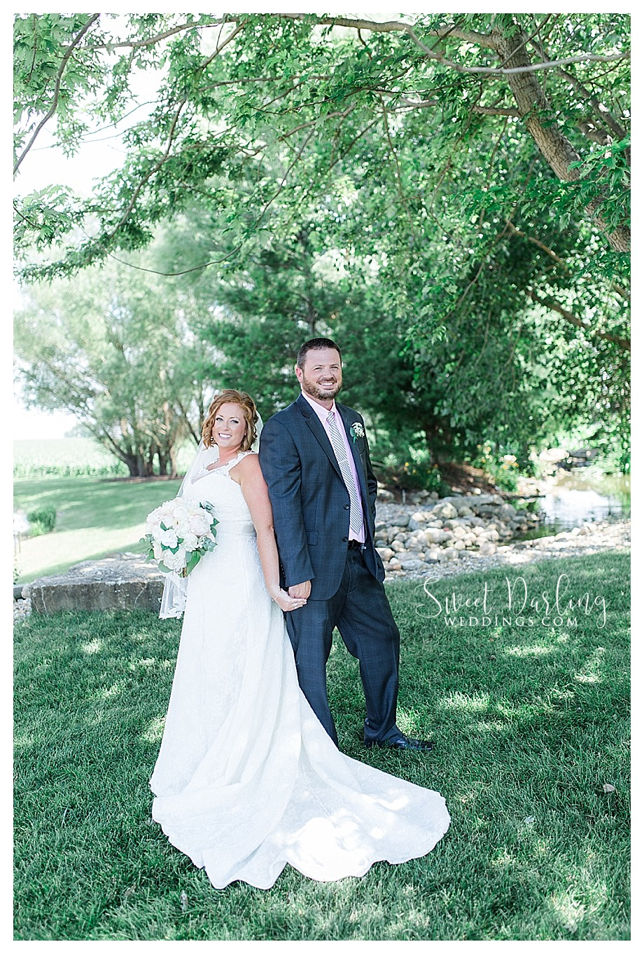 bride and groom outdoors with white flowers