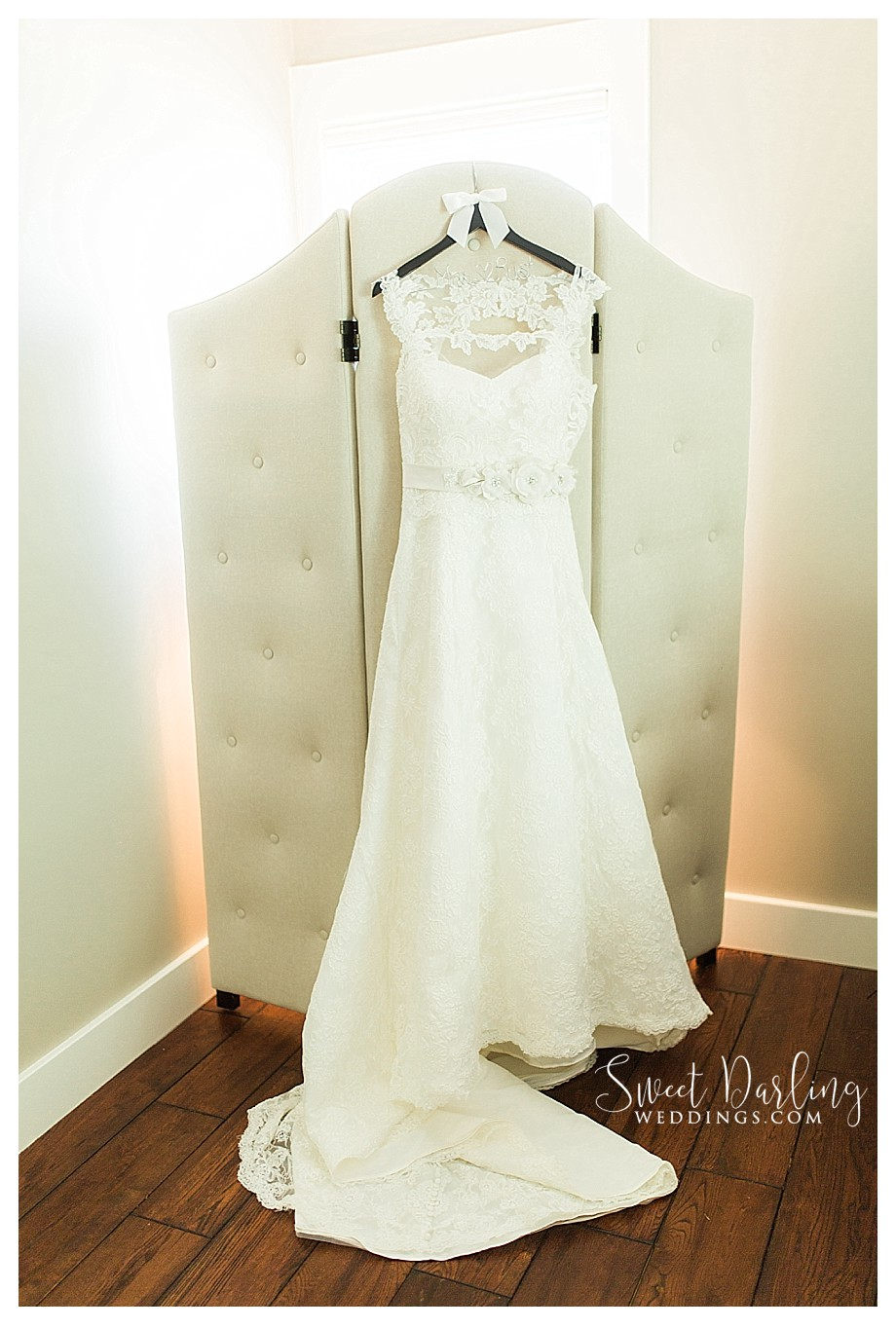 wedding dress on custom wooden hanger