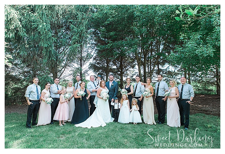 large wedding bridal party in champagne black and blush