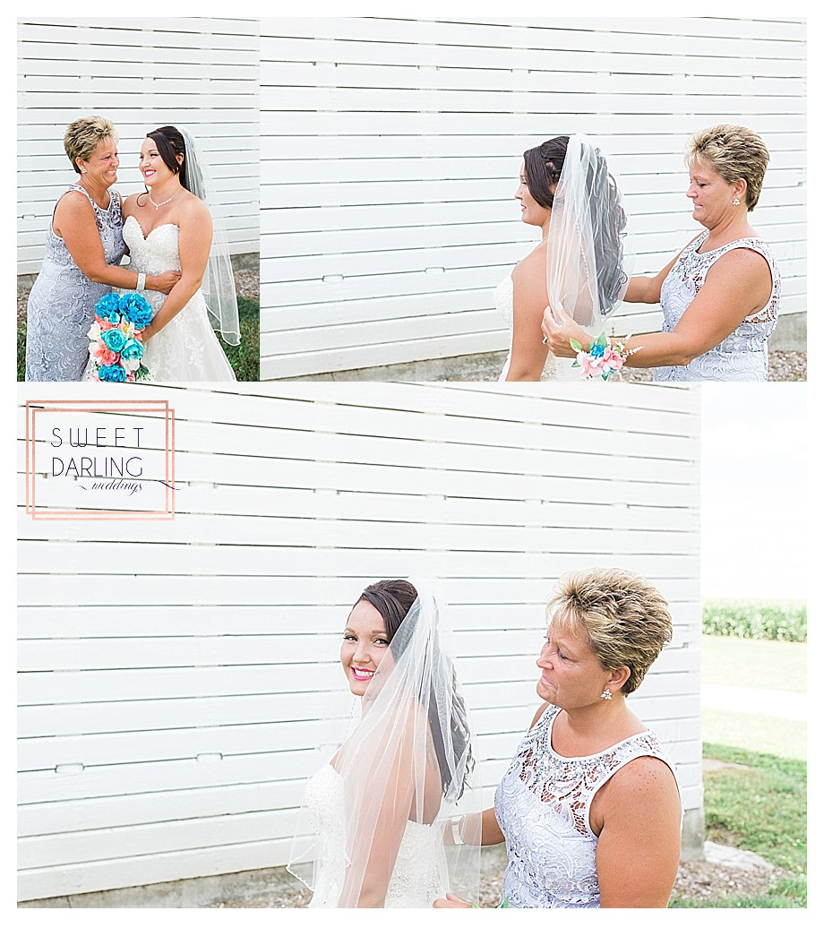 mother daughter with veil on wedding day