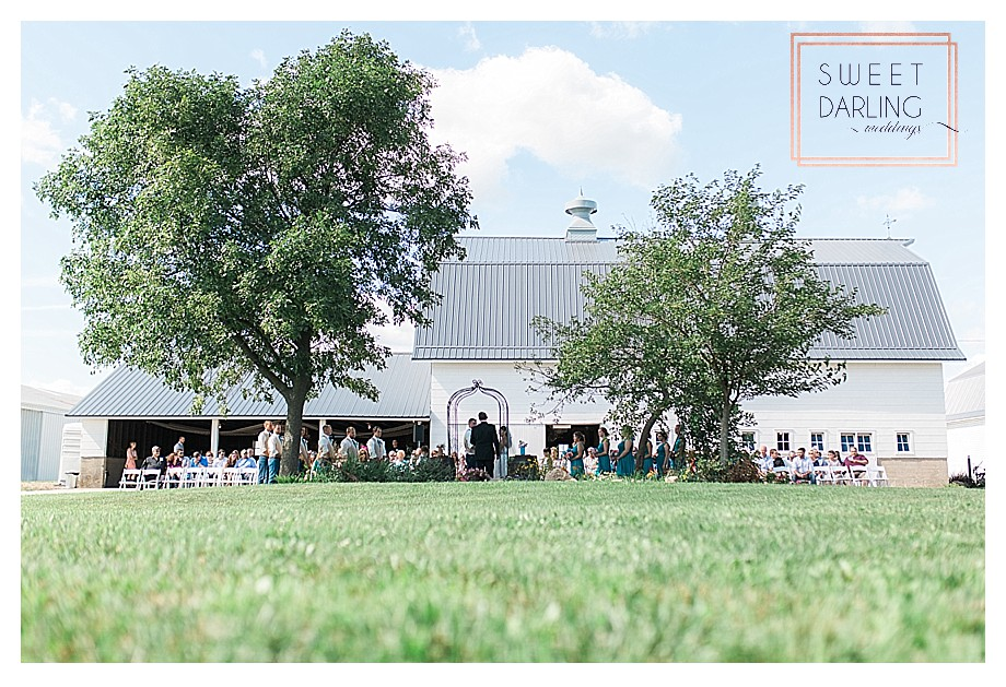 country wedding ceremony outside of restored barn