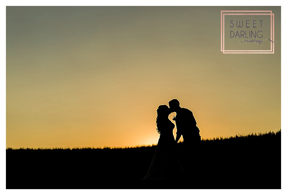 silhouette pic of bride and groom on farm