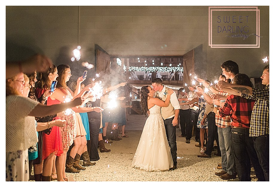 bride groom sparkler fun on wedding day in country