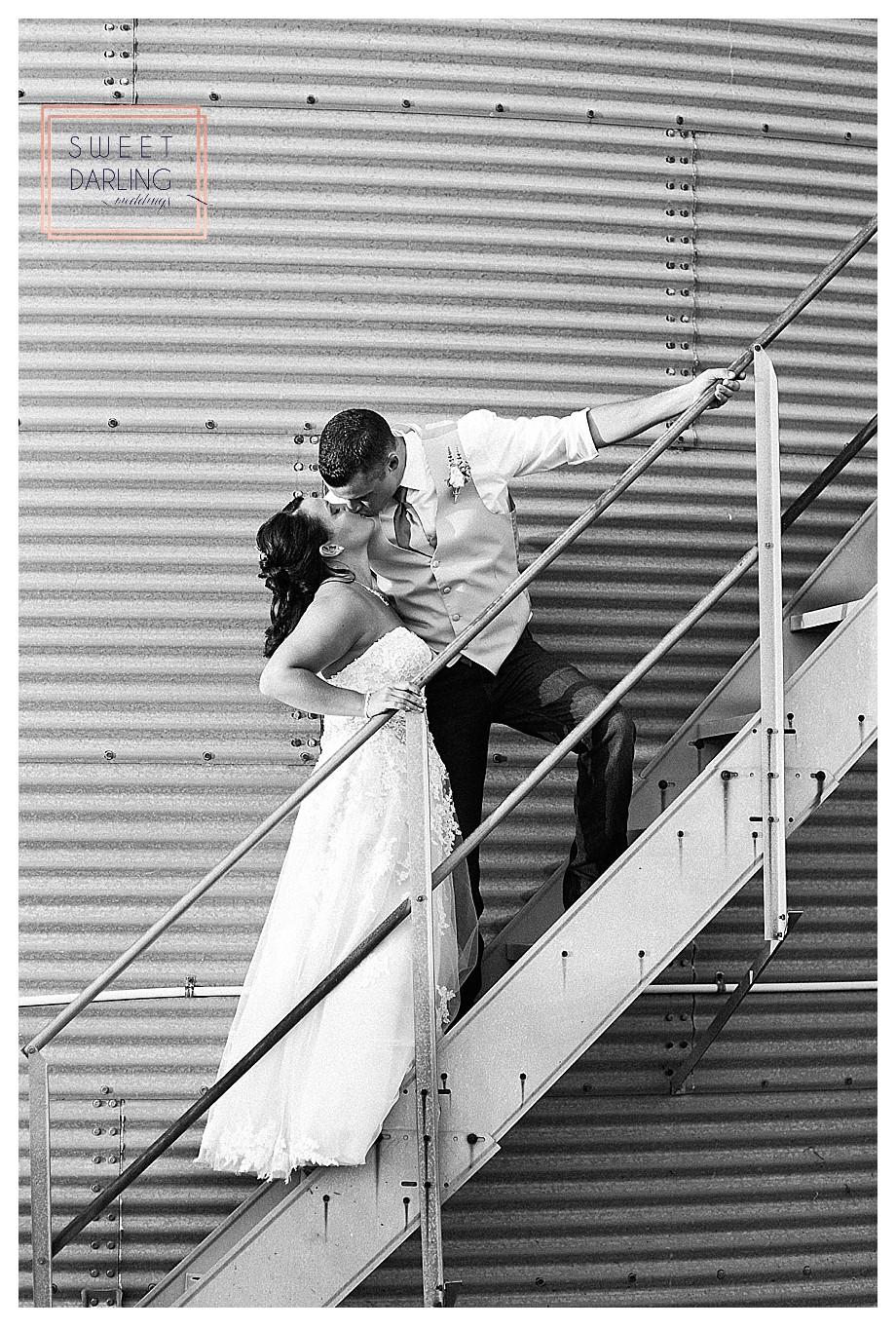 bride and groom on steps of grain bin