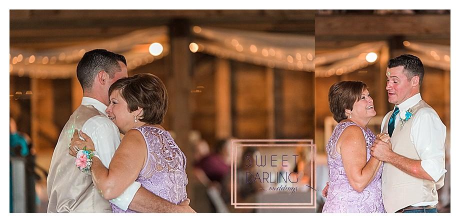 mother wearing lavendar dress son dance at wedding