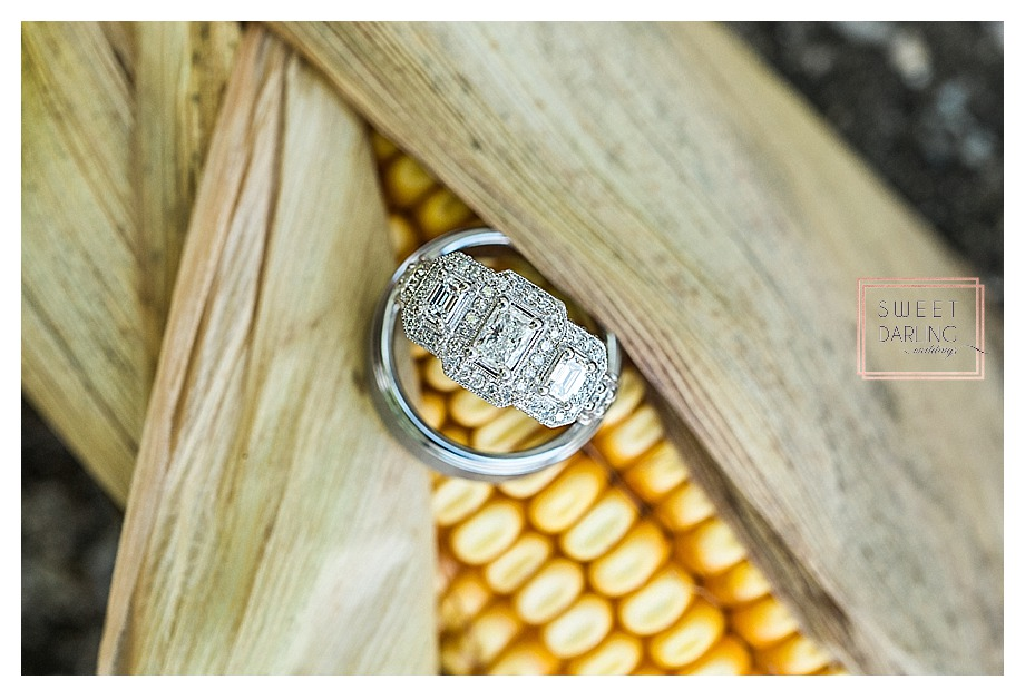 ring on ear of corn at country wedding