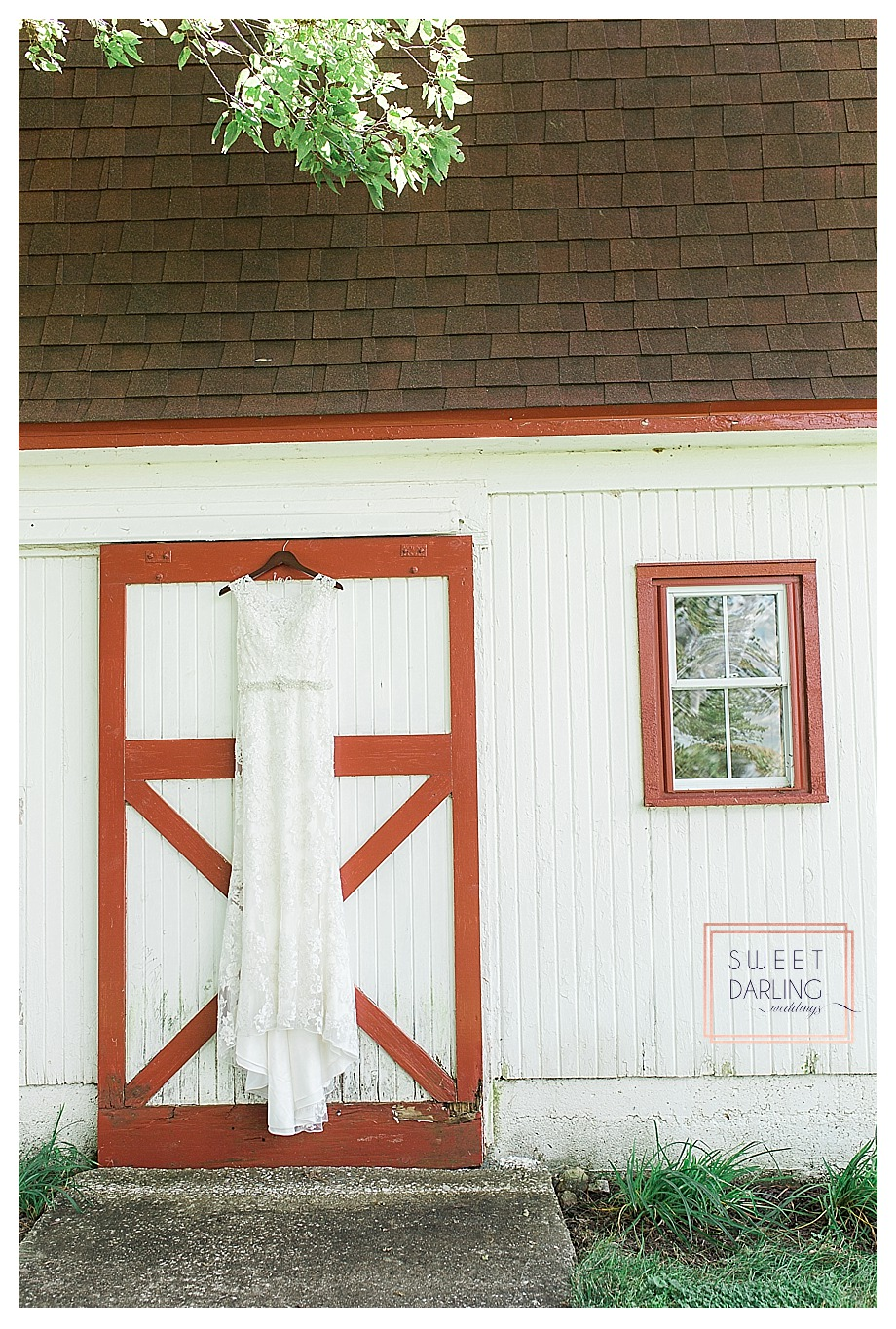 white lace slip dress hanging on barn