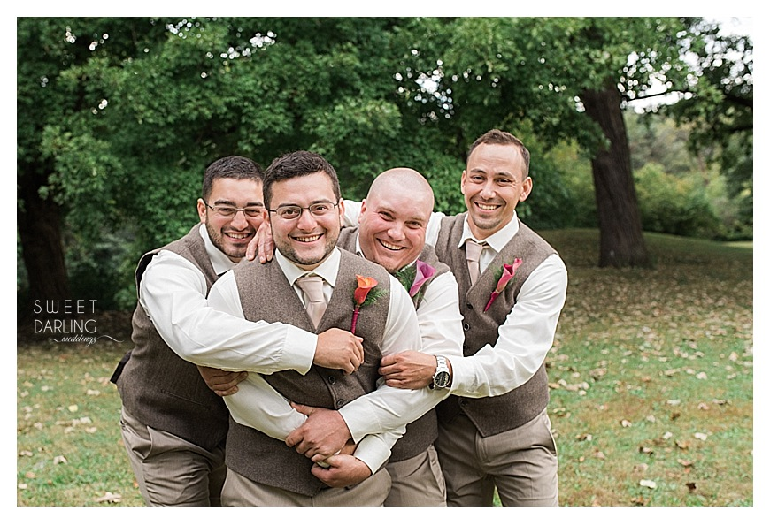 groomsmen hugging the groom is a fun pose