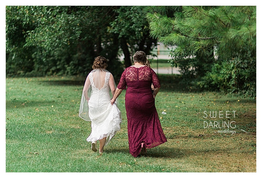 mother and daugther walking together on wedding day