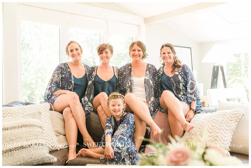 Bridesmaids in robes at Pear Tree Estate
