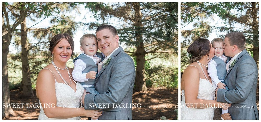 Wedding couple holding son at Pear Tree Estate