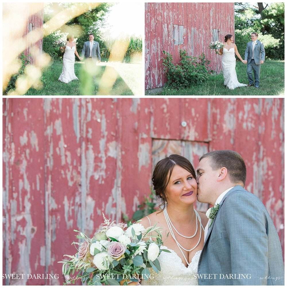 Groom kissing bride at red barn in Champaign, IL