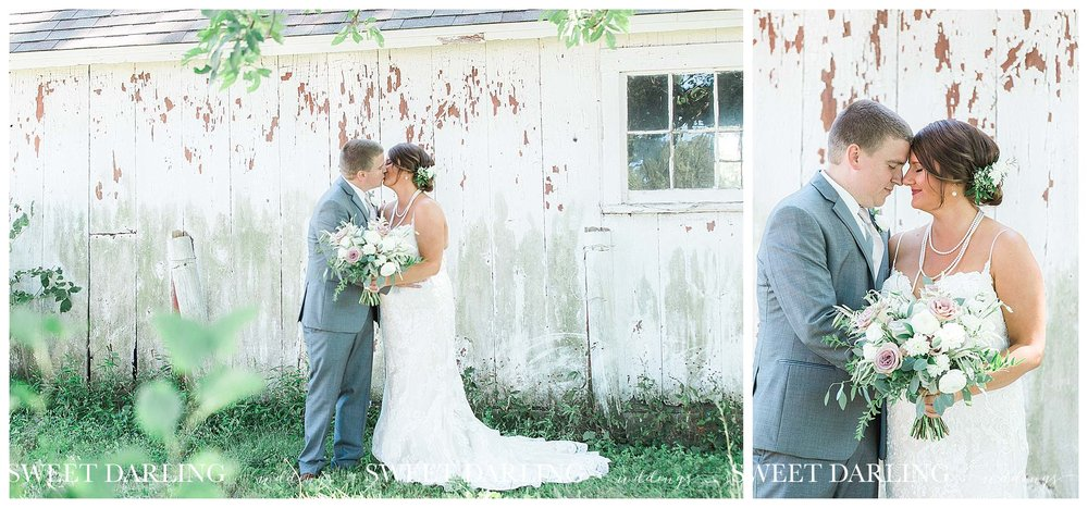 Romantic bride and groom by white barn