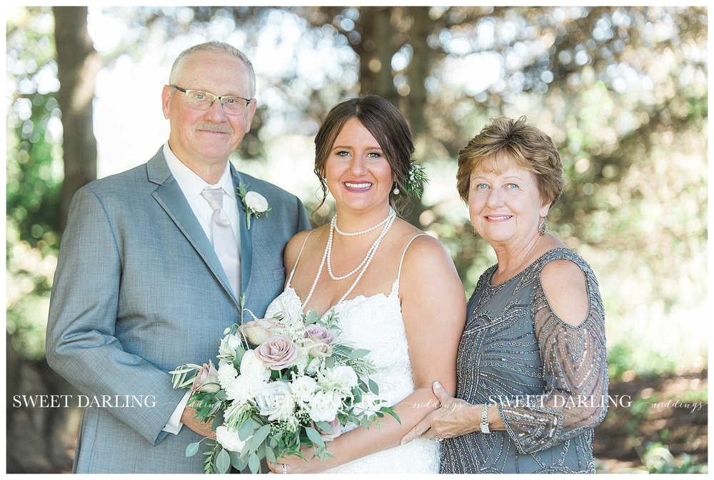 Bride with parents at pear tree estate