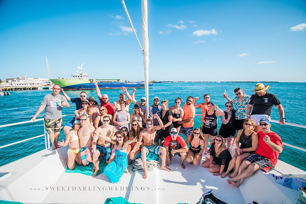 Family gathered for group photo on catamaran in Cancun, Mexico