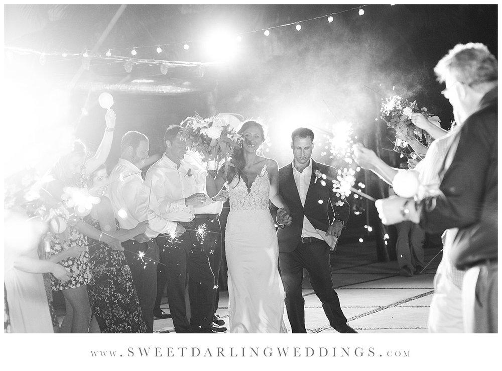 Sparkler entrance with bride and groom at secrets silversands