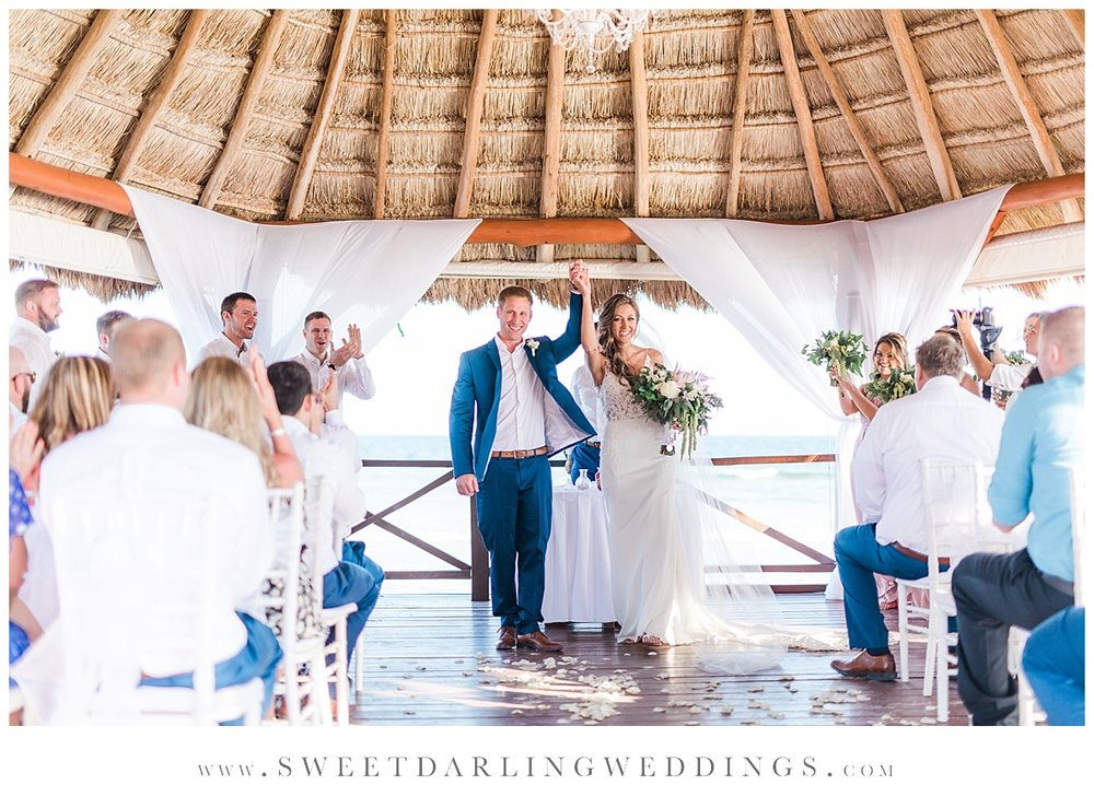 Bride and groom exit wedding in gazebo at Secrets Silversands