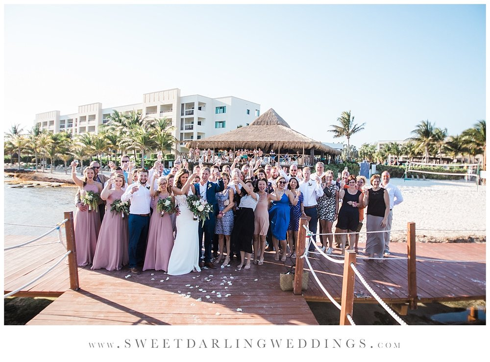 Wedding guests enjoy champagne toast after wedding at secrets silversands