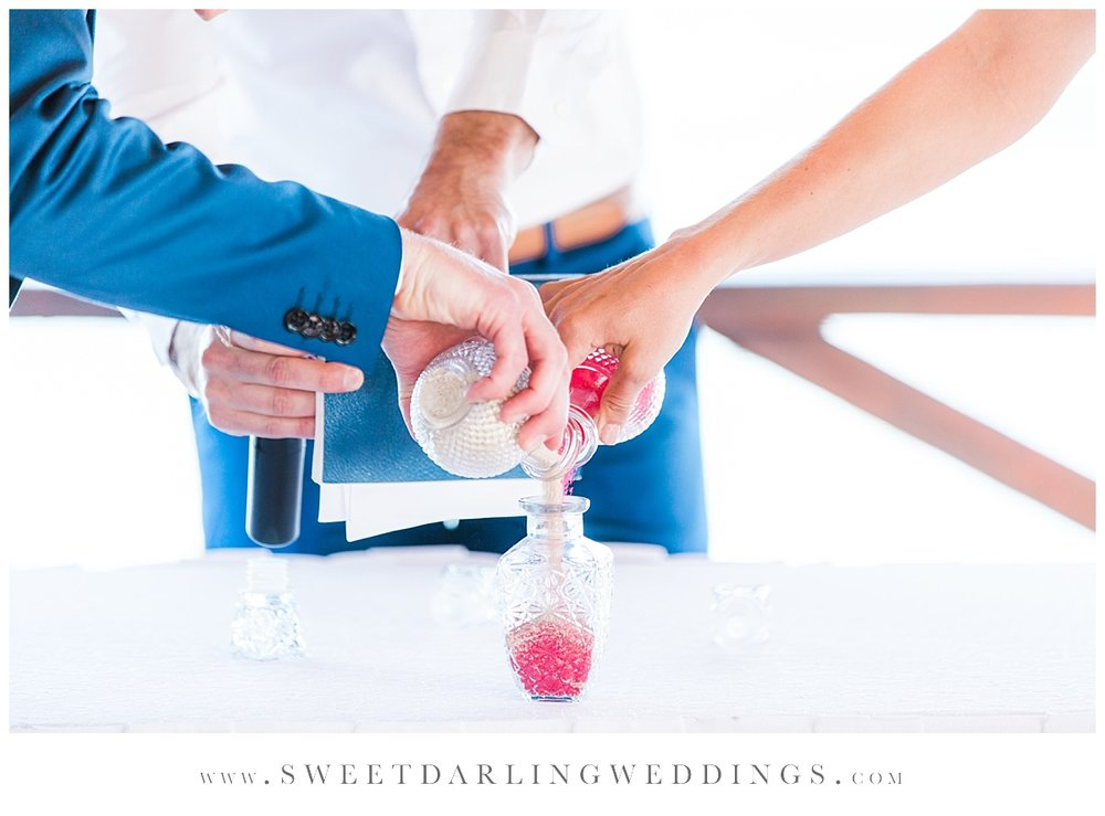 Sand ceremony during wedding at Secrets Silversands