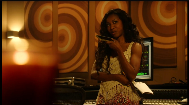 Jack of all trades, Pippy Rosewood (Gabrielle Dennis) records in the studio and proxides toxicology reports simultaneously.