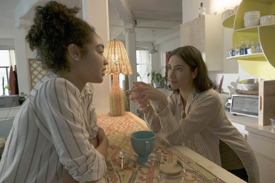Kat (Aisha Dee) and Adena (Nikohl Boosheri) talking