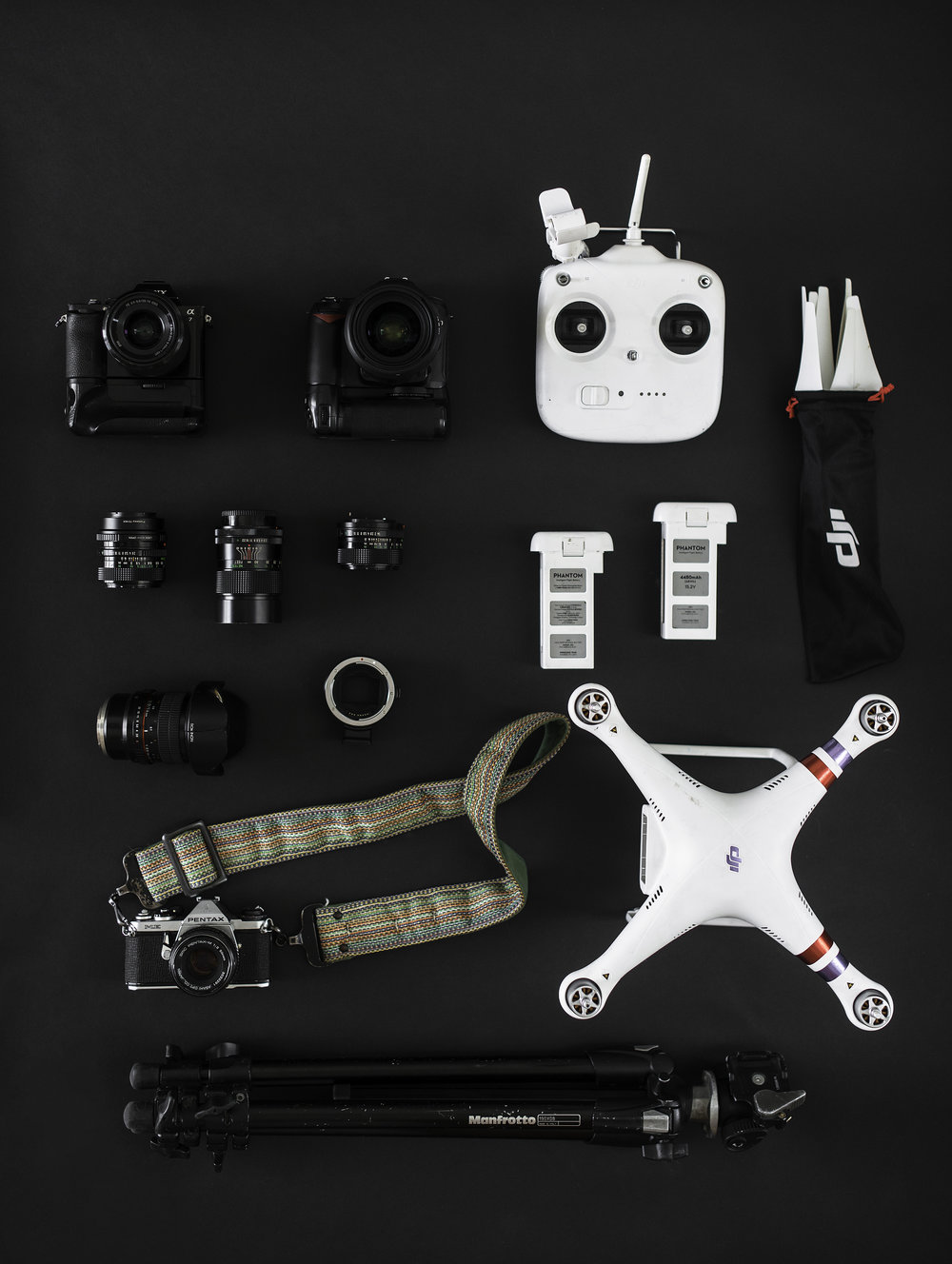 Overhead of Sony A7, Phantom 3, Nikon DSLR, Lenses and Tripod for Blog Post about Gear
