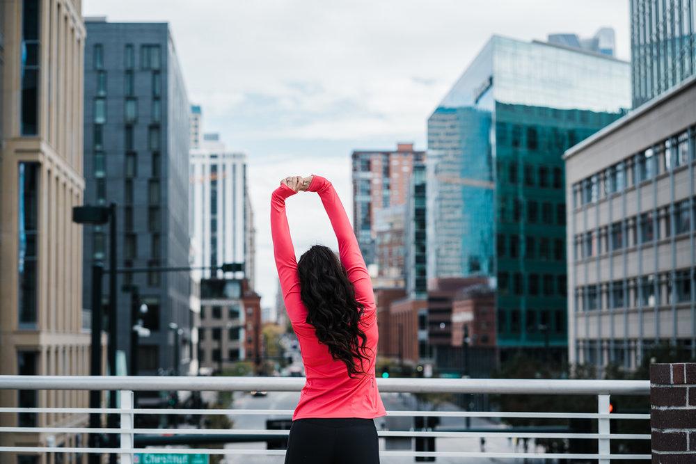 Girl-Stretching-Downtown-Denver.jpg
