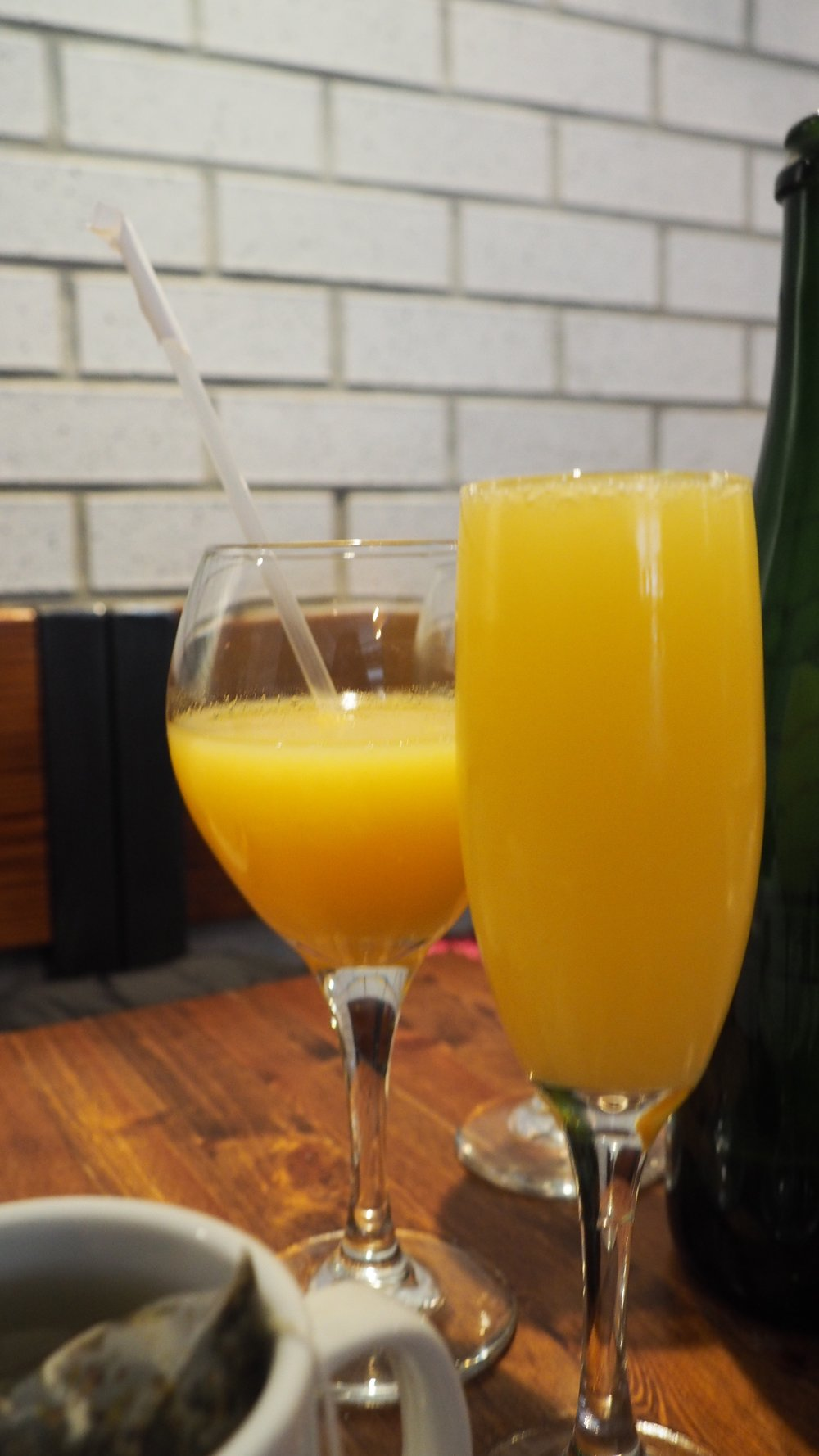 Their brunch menu gives you a free coffee/tea AND a choice of mimosa, orange juice, and other breakfast drinks. Key word: free.