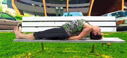 nan yoga in a fish pose on a park bench