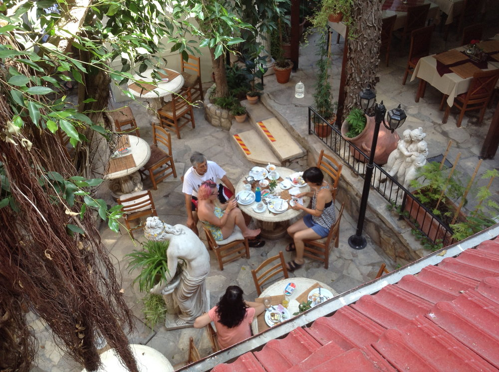 Courtyard of the Kinyras Hotel and Taverna, Paphos, Cyprus.