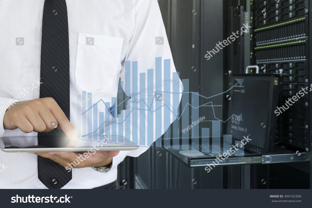 stock-photo-business-man-use-tablet-for-analyze-in-data-center-409162306.jpg
