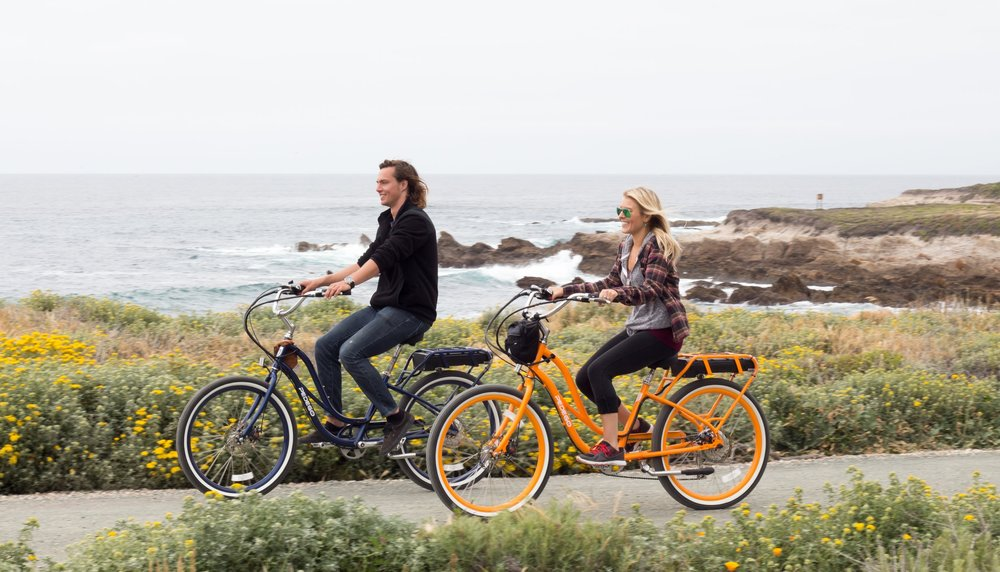 Biking on Pedego electric bikes in downtown Avila beach. Photo by Pedego Avila Beach.