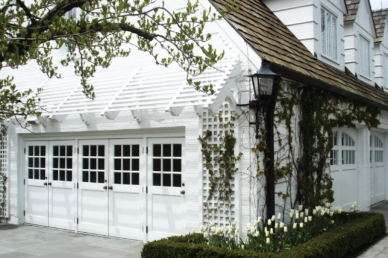 custom wood garage doors w northern lites.png