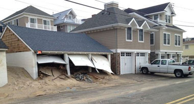 NOTE: The photo above was taken on the shoreline of New Jersey in 2012 following Hurricane Sandy's storm surge. The doors on the left are a competitor's steel doors. The doors on the right are Designer Doors. They not only protected the structure and its contents, but they're still beautiful.