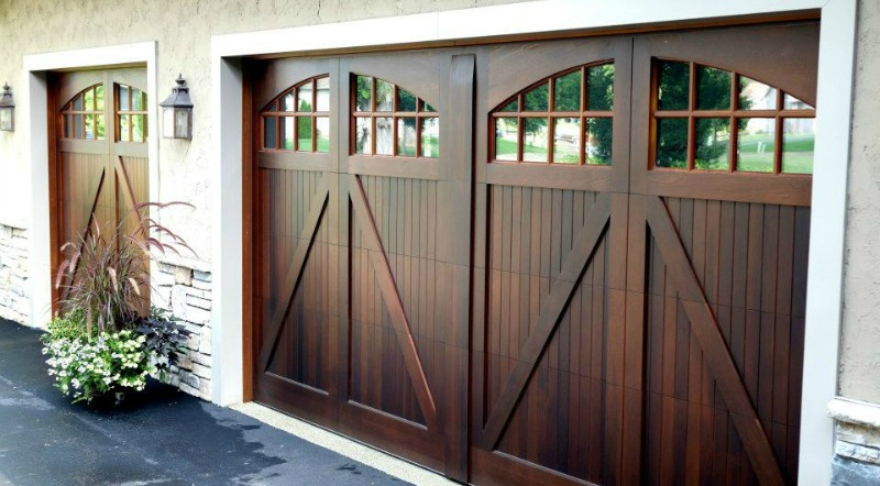 Custom-made single and double wood garage doors with half bucks