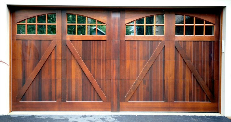 Double-wide, custom-made wood garage door that looks like two single doors