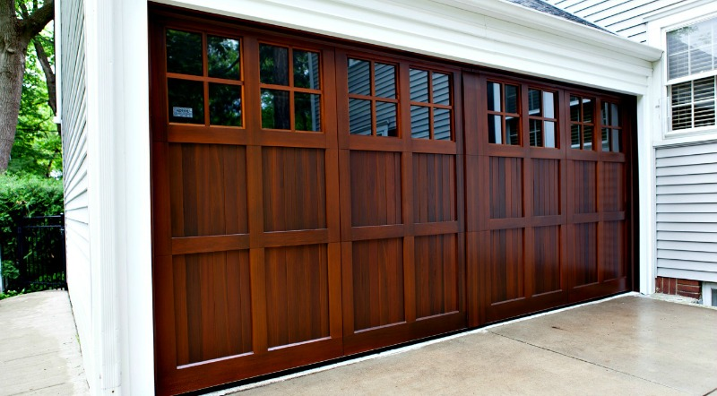 Custom-designed wood garage door with a patent-pending simulated center post