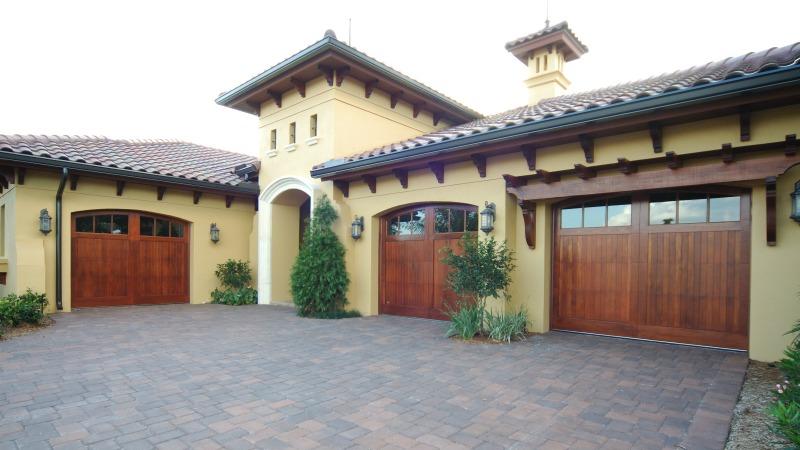 Spanish,  Mediterranean, Southwest Style wooden garage doors