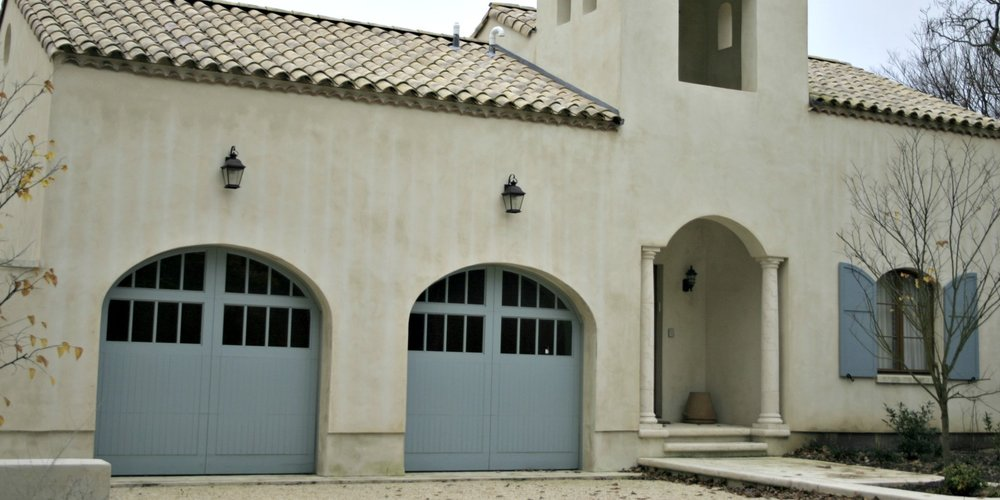 Spanish, Mediterranean style wood garage doors