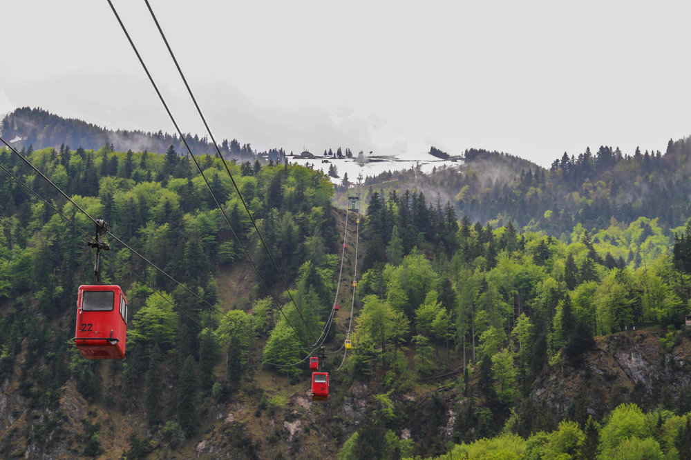 many cable carts over the mountain in snow