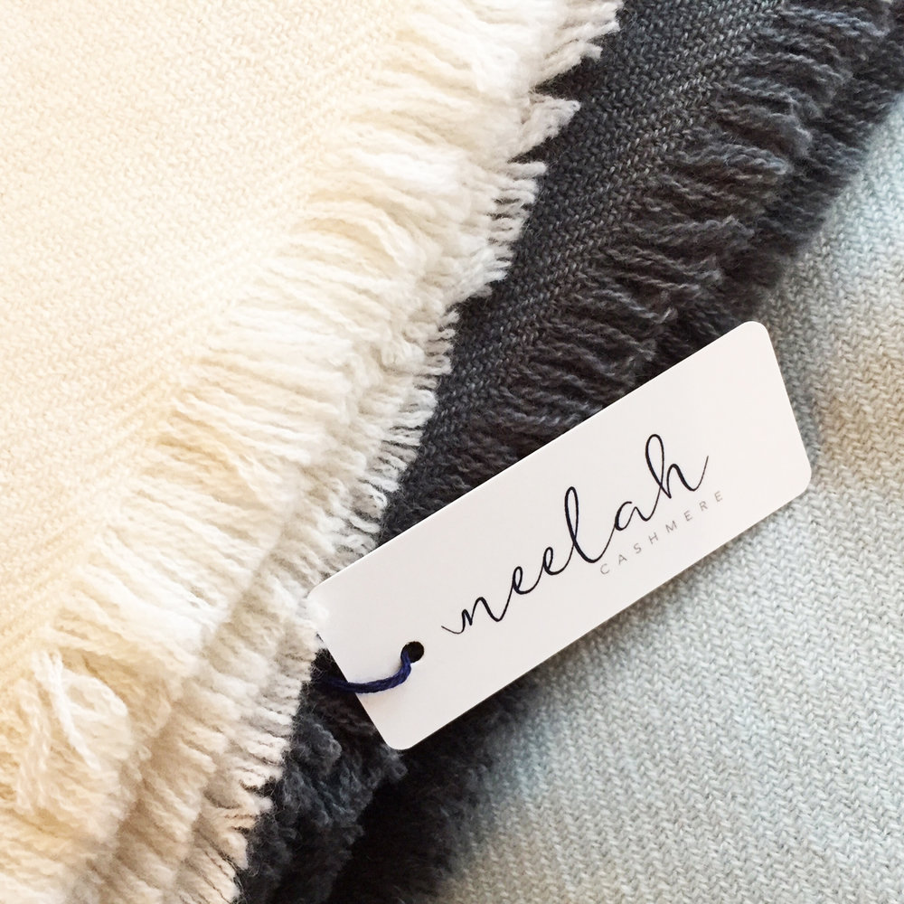 Neelah throws shown in ivory, graphite and powder blue.