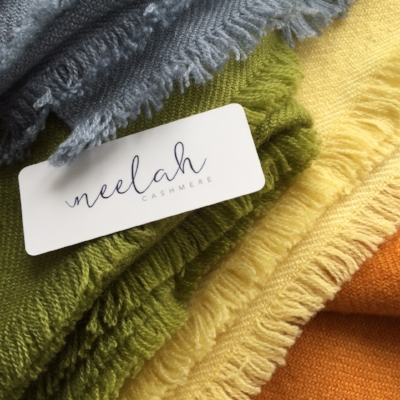 Neelah  throws shown in tidal blue, grass, daffodil and saffron.