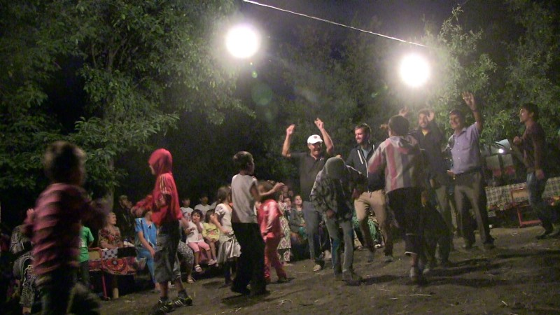 In earshot of Afghanistan, but nobody's turning down the music. A well-placed hello lands us in a Tajik village party.